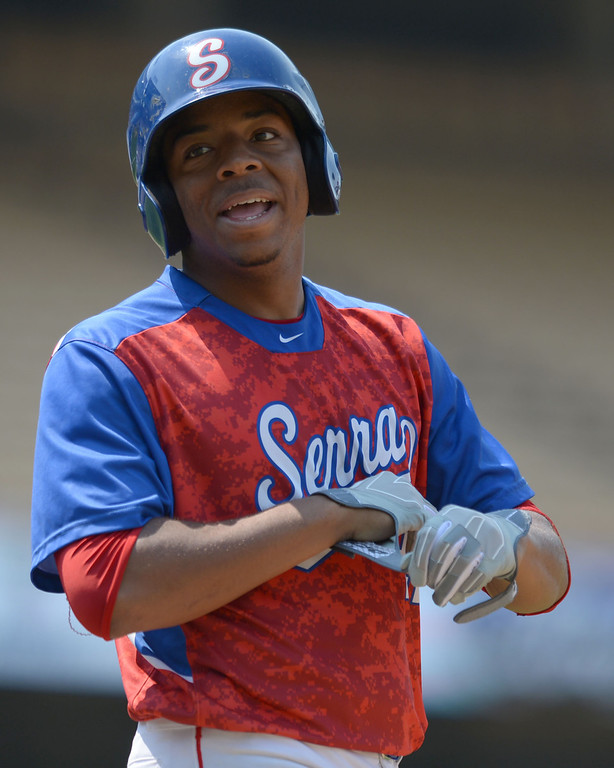 . Serra\'s Dominic Smith (22) laughs at jeers from the Mira Costa fans after he drove home a run in the CIF-SS Division III championship baseball game Friday at Dodger Stadium. Serra won the title, 8-1. 20130531 Photo by Steve McCrank / Staff Photographer