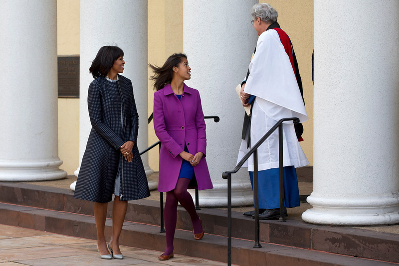 . First lady Michelle Obama and daughter Malia say goodbye to Rev. Luis Leon as they leave St. John\'s Church in Washington, Monday, Jan. 21, 2013, after a church service during the 57th Presidential Inauguration. (AP Photo/Jacquelyn Martin)