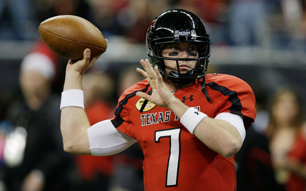 Description of . Seth Doege #7 of Texas Tech looks to pass during warmups prior to the start of the game against Minnesota during the Meineke Car Care of Texas Bowl at Reliant Stadium on December 28, 2012 in Houston, Texas.  (Photo by Scott Halleran/Getty Images)