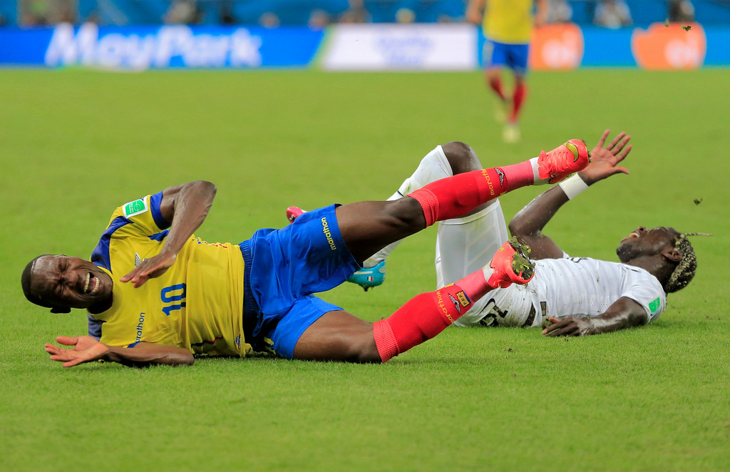 . Ecuador\'s Walter Ayovi and France\'s Bacary Sagna lie on the pitch after colliding with one another during the group E World Cup soccer match between Ecuador and France at the Maracana Stadium in Rio de Janeiro, Brazil, Wednesday, June 25, 2014. (AP Photo/Bernat Armangue)