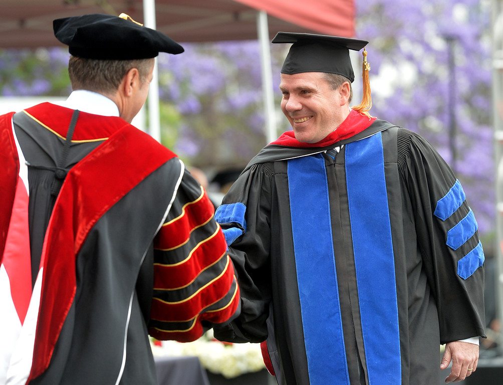 . Gregory Smith receives his diploma during the Commencement Ceremony at Biola University in La Mirada on Friday May 23, 2014. Kay Warren, International speaker and author, gives the commencement address. (Photo by Keith Durflinger/Whittier Daily News)