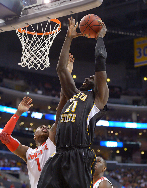 . Wichita State center Ehimen Orukpe (21) goes up against Ohio State forward Deshaun Thomas (1) during the first half of the West Regional final in the NCAA men\'s college basketball tournament, Saturday, March 30, 2013, in Los Angeles. (AP Photo/Mark J. Terrill)
