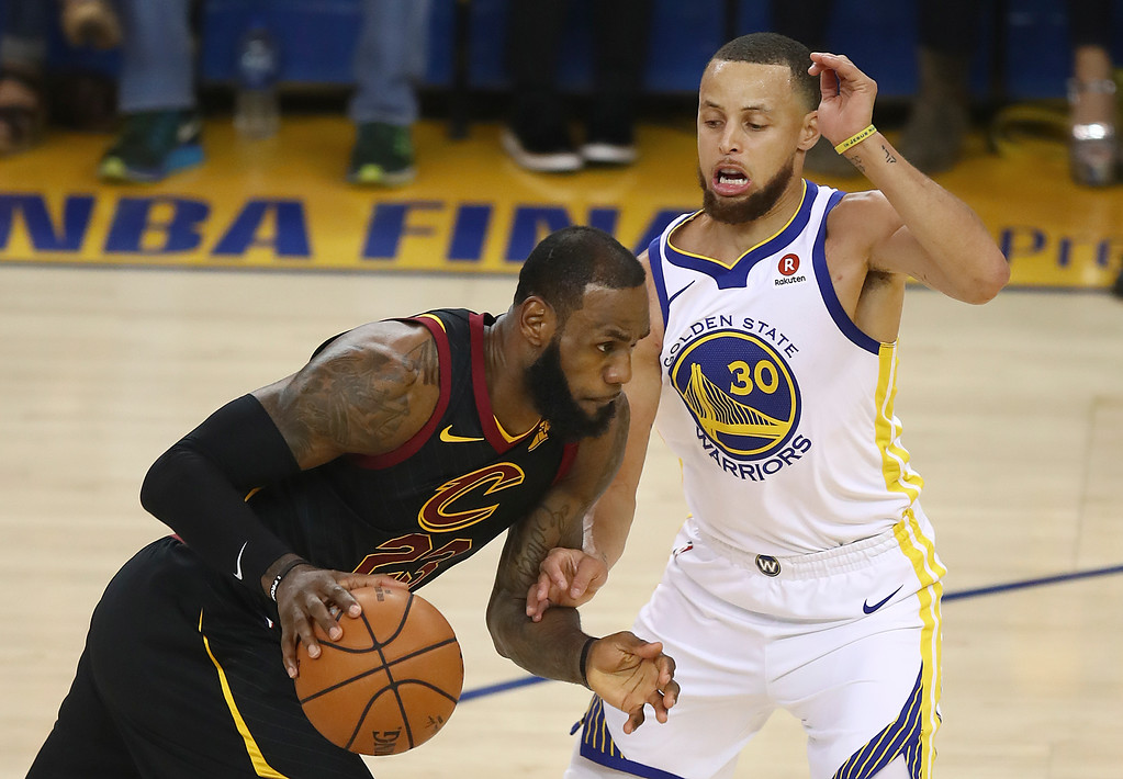 . Cleveland Cavaliers forward LeBron James, left, drives against Golden State Warriors guard Stephen Curry during the first half of Game 1 of basketball\'s NBA Finals in Oakland, Calif., Thursday, May 31, 2018. (AP Photo/Ben Margot)