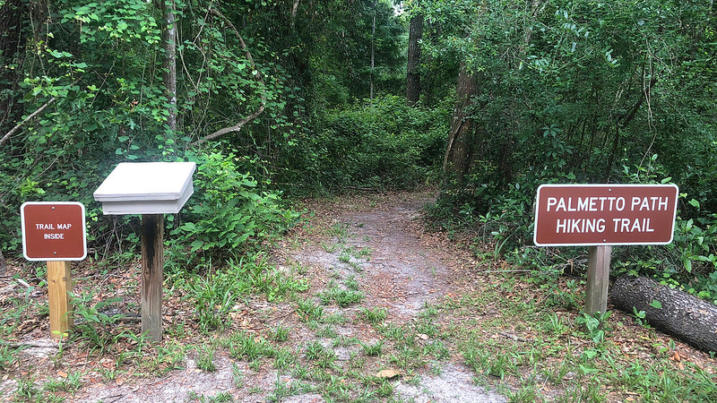 Trail entrance with sign and map box
