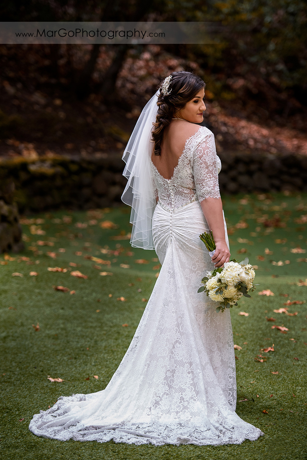 full body portrait of bride in white dress holding wedding bouquet at Saratoga Springs Cathedral Grove