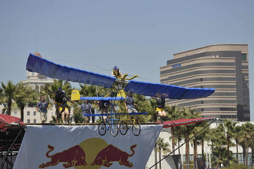 """. LONG BEACH, CALIF. USA -- Justin Dutton pilots his team\'s Flugtag entry \""""Remember the Tritons\"""" in Rainbow Harbor in Long Beach, Calif. on August 21, 2010. Thirty five teams competed in the Red Bull event where teams build homemade, human-powered flying machines and pilot them off a 30-foot high deck in hopes of achieving flight.  Flugtag means \""""flying day\"""" in German. They are on distance, creativity and showmanship..Photo by Jeff Gritchen / Long Beach Press-Telegram.."""