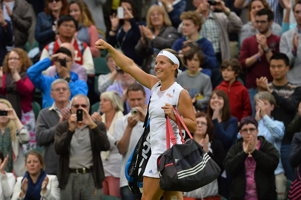 . Belgium\'s Kirsten Flipkens celebrates after beating Czech Republic\'s Petra Kvitova during their women\'s singles quarter-final match on day eight of the 2013 Wimbledon Championships tennis tournament at the All England Club in Wimbledon, southwest London, on July 2, 2013. Flipkens won 4-6, 6-3, 6-4. BEN STANSALL/AFP/Getty Images