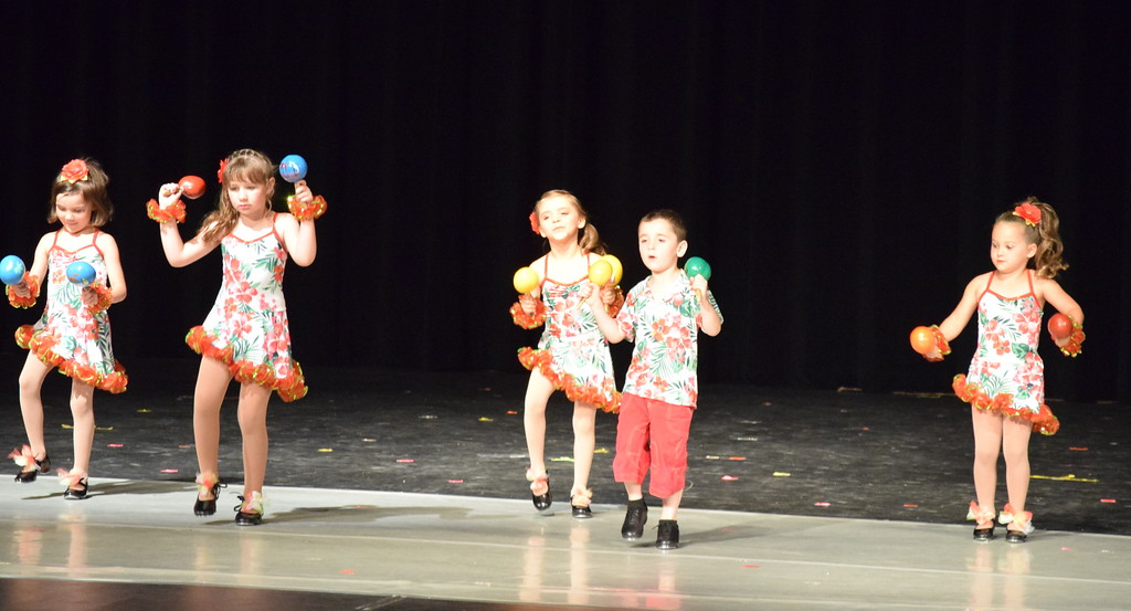 ". Dancers perform to ""Chihuahua\"" at Melissa\'s School of Dance and Gymnastics\' \""Dance In Motion\"" recital Wednesday, June 13, 2018. Back row, from left; Bray Lynne Gower, Victoria Hulbert, Monic Weis. Front row, from left, Ashtyn Fuller and Matthew Baird."