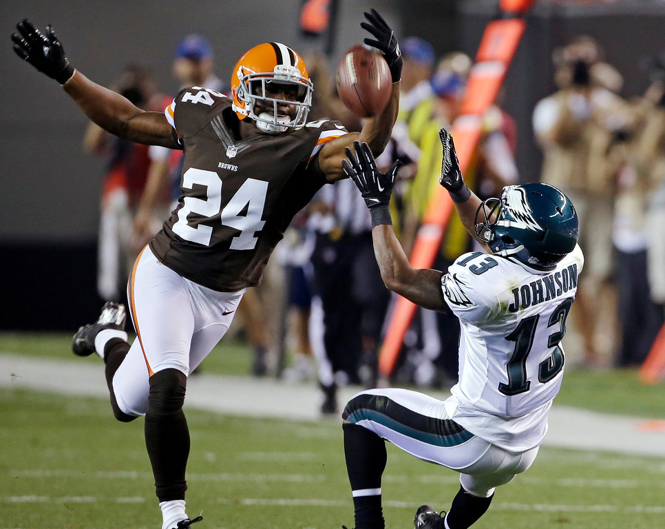 . CLEVELAND BROWNS - Philadelphia Eagles wide receiver Damaris Johnson (13) catches a pass against Cleveland Browns defensive back Sheldon Brown (24) during the second quarter of an NFL preseason football game Friday, Aug. 24, 2012, in Cleveland. (AP Photo/Mark Duncan)
