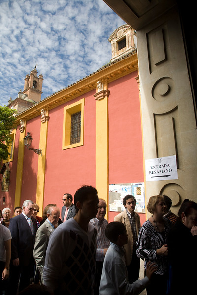 People entering Gran Poder basilica for the hand-kissing of the Christ image on Palm Sunday, Seville, Spain