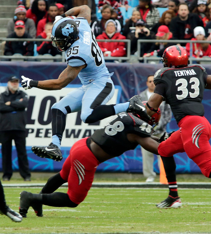 . North Carolina\'s Eric Ebron (85) leaps over Cincinnati\'s Jeff Luc (48) during the first half of the Belk Bowl NCAA college football game, Saturday, Dec. 28, 2013, in Charlotte, N.C. Ebron was selected 10th overall in the first round of the NFL football draft by the Detroit Lions.  (AP Photo/Nell Redmond)