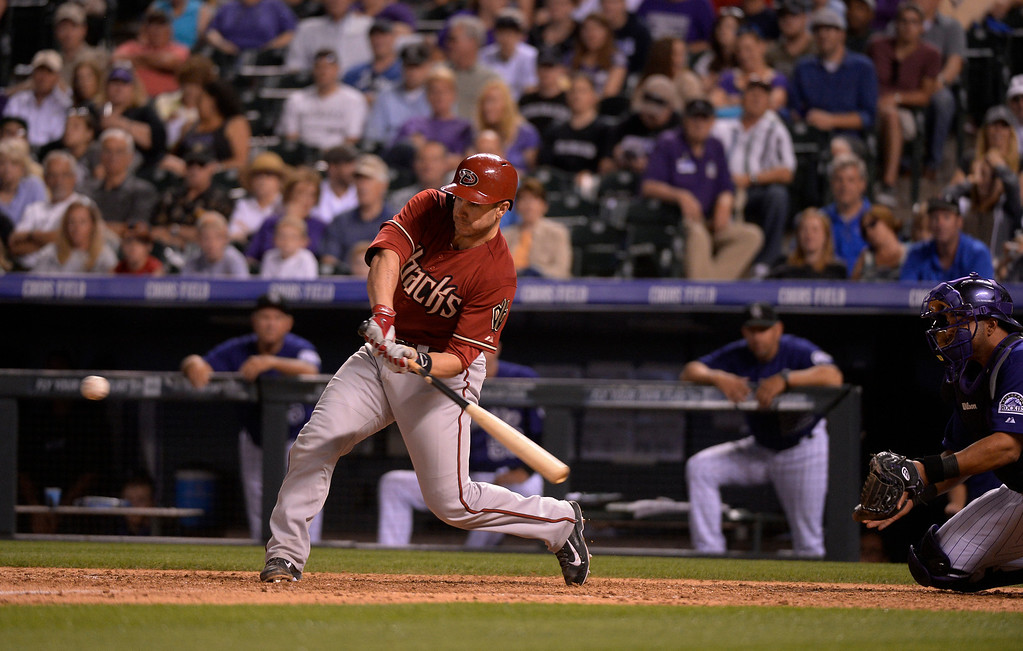 . Arizona Diamondbacks catcher Miguel Montero (26) singles to right field for an RBI against the Colorado Rockies June 4, 2014 at Coors Field. Montero had a 6 RBI night. (Photo by John Leyba/The Denver Post)