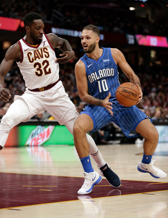 . Orlando Magic\'s Evan Fournier (10), from France, drives past Cleveland Cavaliers\' Jeff Green (32) in the second half of an NBA basketball game, Saturday, Oct. 21, 2017, in Cleveland. (AP Photo/Tony Dejak)