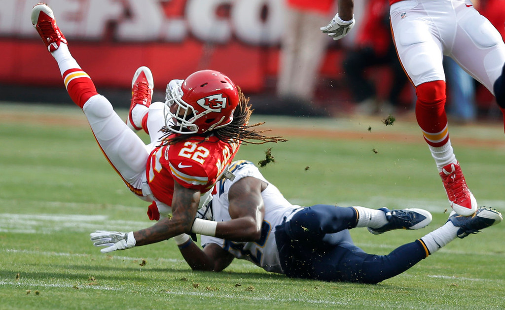 . Kansas City Chiefs wide receiver Dexter McCluster (22) is tackled by San Diego Chargers cornerback Shareece Wright (29) during the first half of an NFL football game in Kansas City, Mo., Sunday, Nov. 24, 2013. (AP Photo/Ed Zurga)