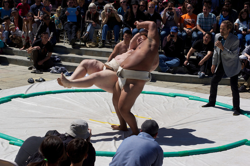 Byamba, Mongolian, three-time World Sumo Champion executes winning move against Kelly in the Sumo Exhibition in Japantown ref: 4cde69a1-92f9-4d49-ab66-2caa3597bd83