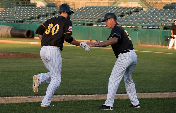 09/03/19 Wesley Bunnell | StaffrrThe New Britain Bees defeated the Somerset Patriots 7-6 in the bottom of the 8th on what was scheduled to be a 7 inning first game of a doubleheader. Logan Moore (30) is greeted by third base coach Chuck Stewart after hitting a 3 run home run to tie the game.