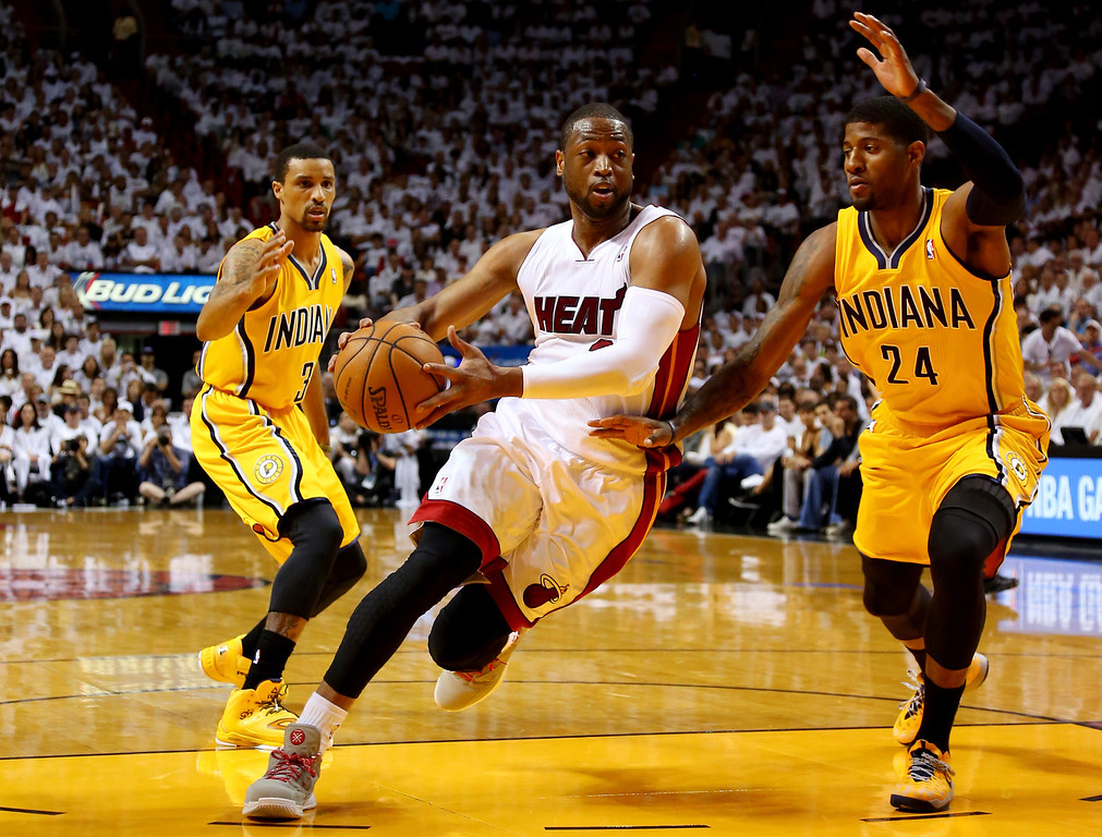 . MIAMI, FL - MAY 30:  Dwyane Wade #3 of the Miami Heat drives to the basket as Paul George #24 of the Indiana Pacers defends during Game Six of the Eastern Conference Finals of the 2014 NBA Playoffs at American Airlines Arena on May 30, 2014 in Miami, Florida.  (Photo by Mike Ehrmann/Getty Images)
