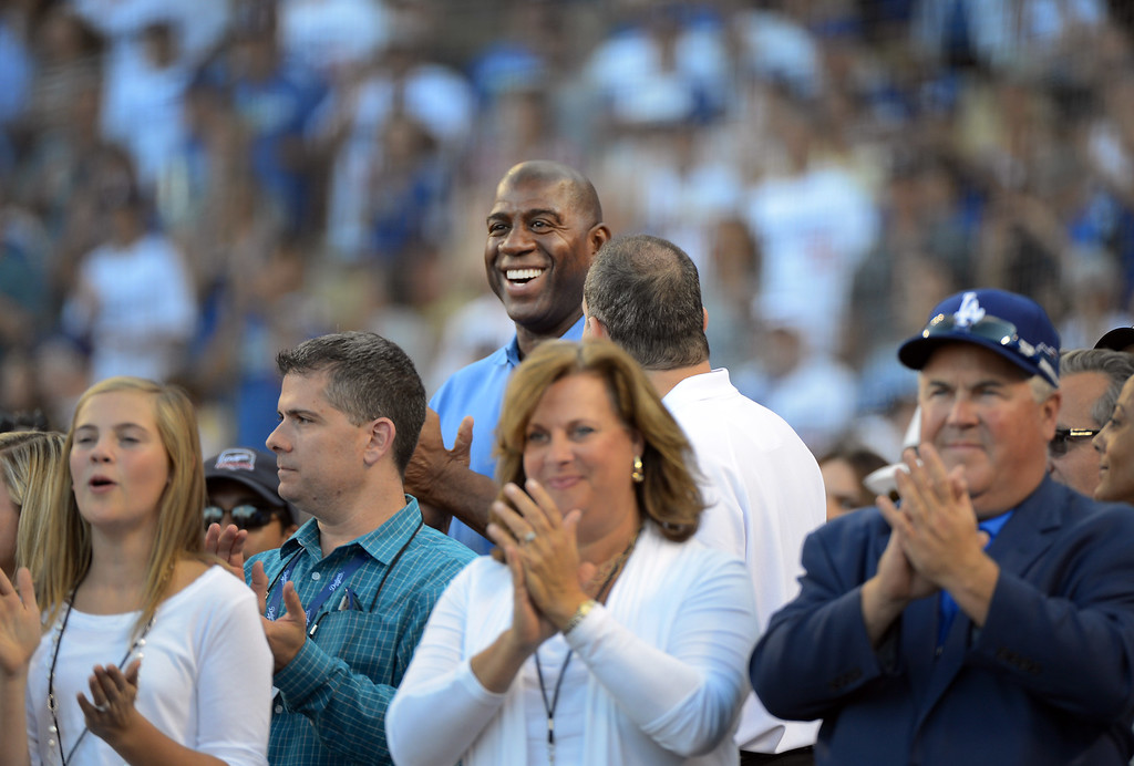 . Los Angeles Dodger\'s owner Magic Johnson smiles before game 3 of the NLDS at Dodger Stadium Sunday, October 6, 2013. (Photo by David Crane/Los Angeles Daily News)