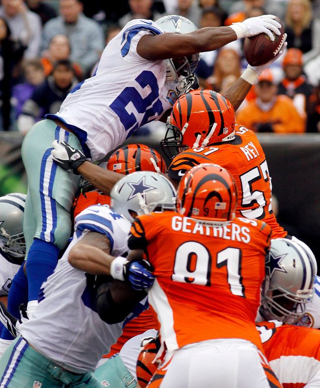 . Dallas Cowboys running back DeMarco Murray (29) dives over the goal line for a 1-yard touchdown run in the first half of an NFL football game against the Cincinnati Bengals, Sunday, Dec. 9, 2012, in Cincinnati. (AP Photo/Tom Uhlman)