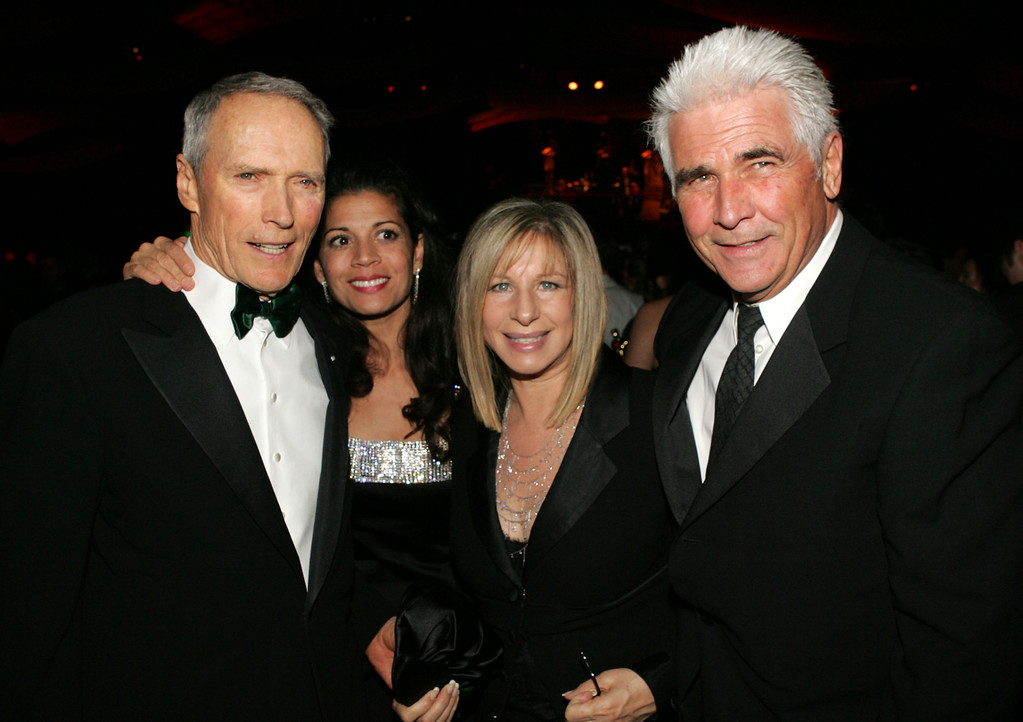 . Director Clint Eastwood, Dina Ruiz Eastwood, Barbra Streisand and James Brolin attend the Governors Ball after the 77th Annual Academy Awards at the Renaissance Hollywood Hotel on February 27, 2005 in Hollywood, California.  (Photo by Vince Bucci/Getty Images)