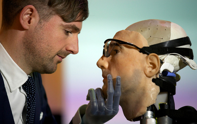 ". Researcher Bertolt Meyer, a lifelong user of prosthetic technology and the model for ""Rex\"", the world\'s first \""bionic man\"", poses with the humanoid during a photo call at the Science Museum in London on February 5, 2013. The 640,000 GBP (1 million US dollars) bionic has a distinctly human shape and boasts prosthetic limbs, a functional artificial blood circulatory system complete with artificial blood, as well as an artificial pancreas, kidney, spleen and trachea. Rex will be displayed at the Science Museum from February 7.  ANDREW COWIE/AFP/Getty Images"