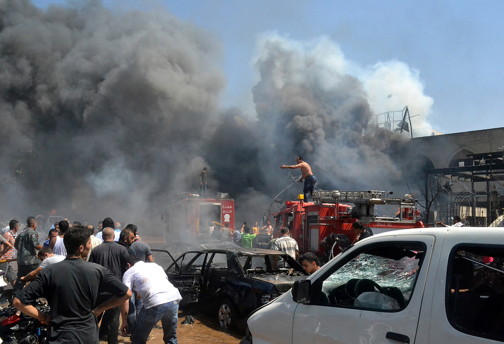 . Lebanese citizens gather at the site of an explosion outside of a mosque in the northern city of Tripoli, Lebanon, Friday Aug. 23, 2013.  (AP Photo)