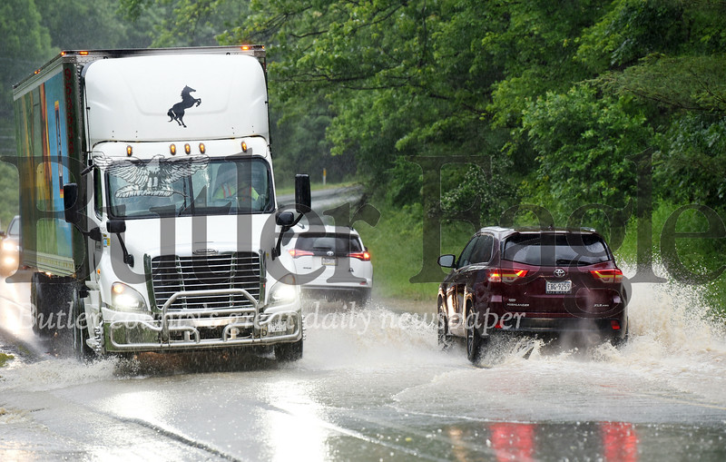 Harold Aughton/Butler Eagle: Flash flooding caused traffic delays along route 228 during rush hour Monday, June 10.