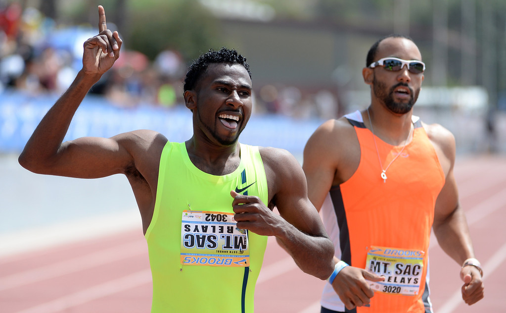 . Yousef Masrah reacts after winning the 400 meter Dash Invitational Elite during the Mt. SAC Relays in Hilmer Lodge Stadium on the campus of Mt. San Antonio College in Walnut, Calif., on Saturday, April 19, 2014. 