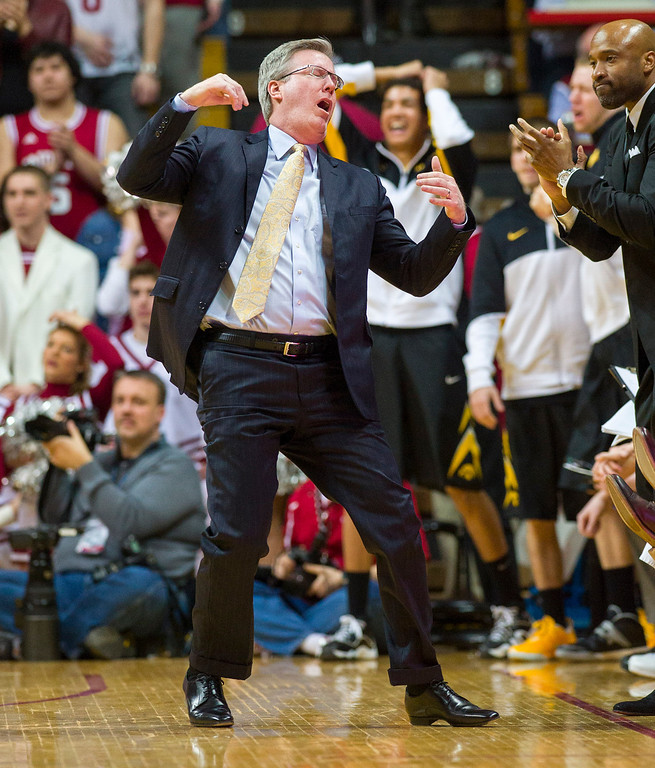 . Iowa head coach Fran McCaffery reacts to a call on the floor in the first half of an NCAA college basketball game against Indiana, Thursday, Feb. 27, 2014, in Bloomington, Ind. (AP Photo/Doug McSchooler)