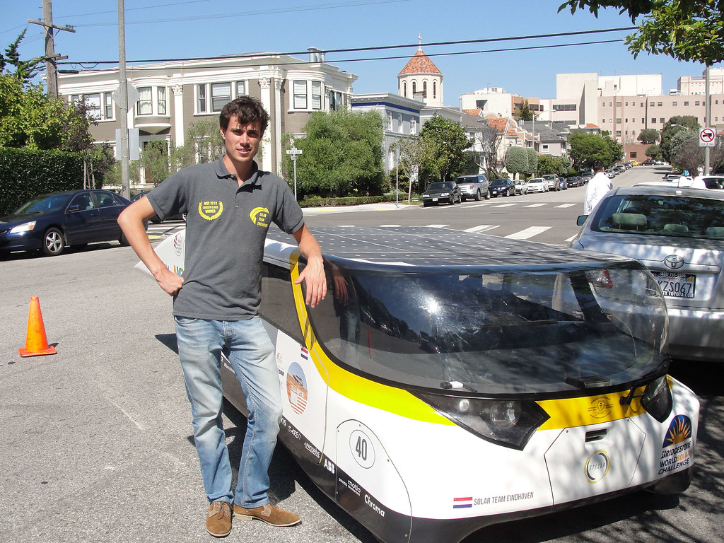 . Solar Team Eindhoven manager Lex Hoefsloot poses with solar-power car \'Stella\' outside Dutch Consulate Residence in San Francisco, September 22, 2014. GLENN CHAPMAN/AFP/Getty Images