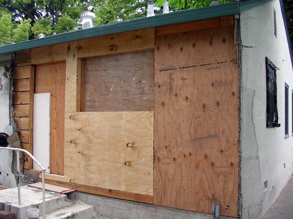 May 15, 2005.  The framing and shear panel wait for windows and a door.  There's been a fair amount of drama with the windows - delayed in production, arrived in the wrong configuration, blah, blah...  at any rate - they're late!