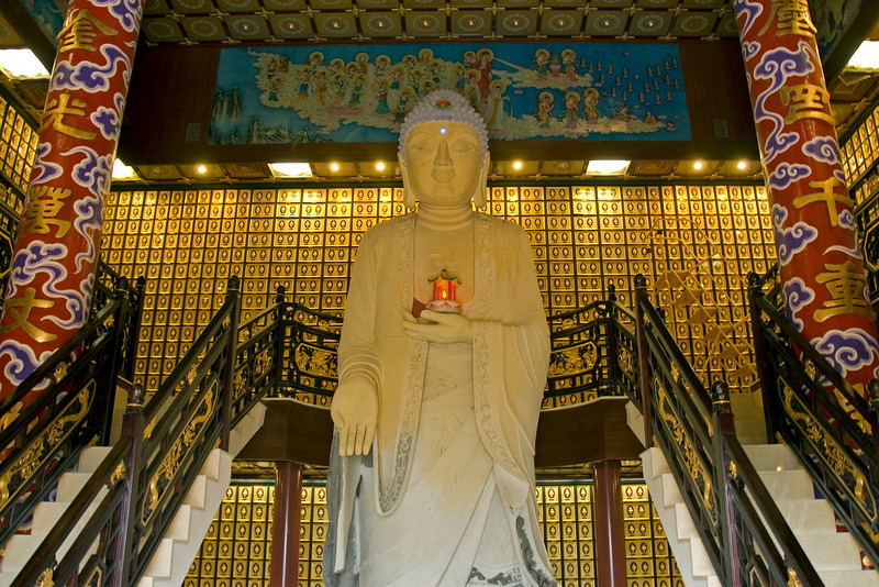 Large Buddha statue by the stairs at 10,000 Buddhas Temple in Hong Kong