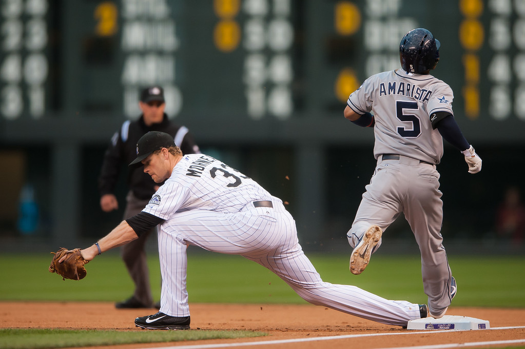 . DENVER, CO - SEPTEMBER 05:  Justin Morneau #33 of the Colorado Rockies forces out Alexi Amarista #5 of the San Diego Padres at first base int he first inning of a game at Coors Field on September 5, 2014 in Denver, Colorado.  (Photo by Dustin Bradford/Getty Images)