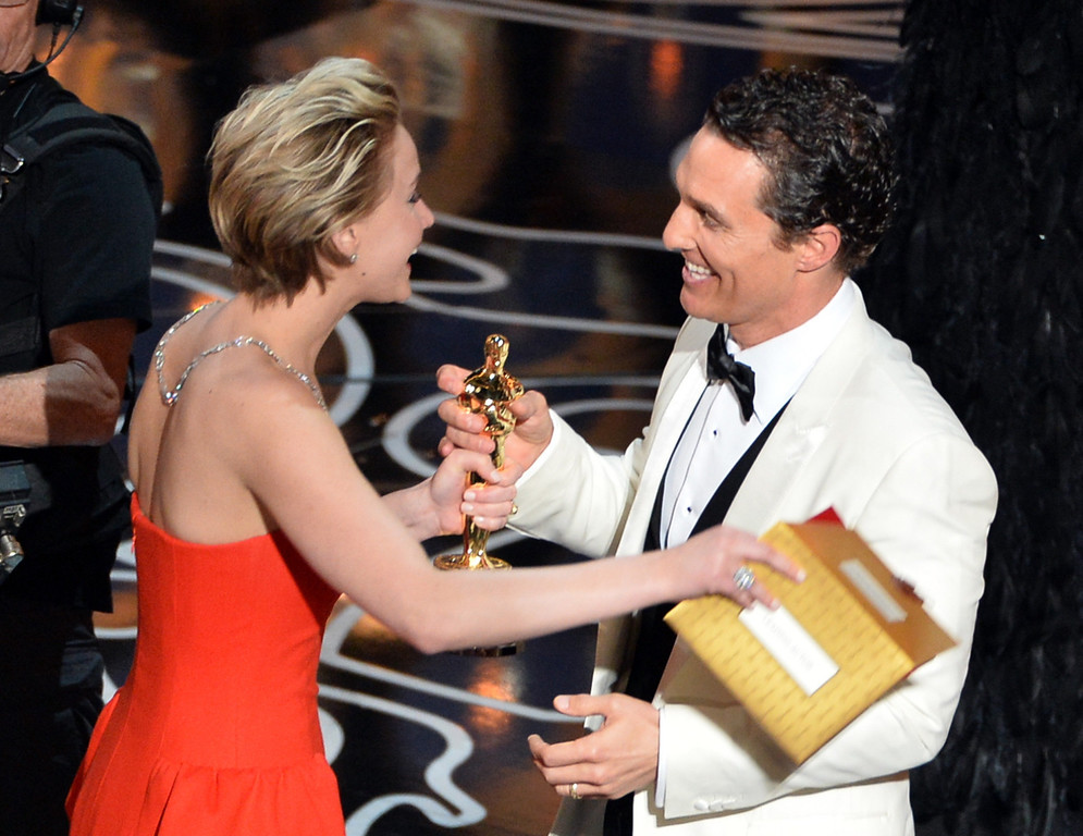. Actor Matthew McConaughey (R) accepts the Best Performance by an Actor in a Leading Role award for \'Dallas Buyers Club\' from actress Jennifer Lawrence (L) onstage during the Oscars at the Dolby Theatre on March 2, 2014 in Hollywood, California.  (Photo by Kevin Winter/Getty Images)