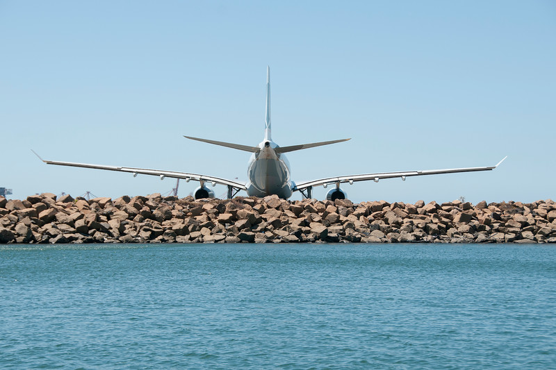 Commercial aircraft on the tarmac, stern view, Sydney Australia.