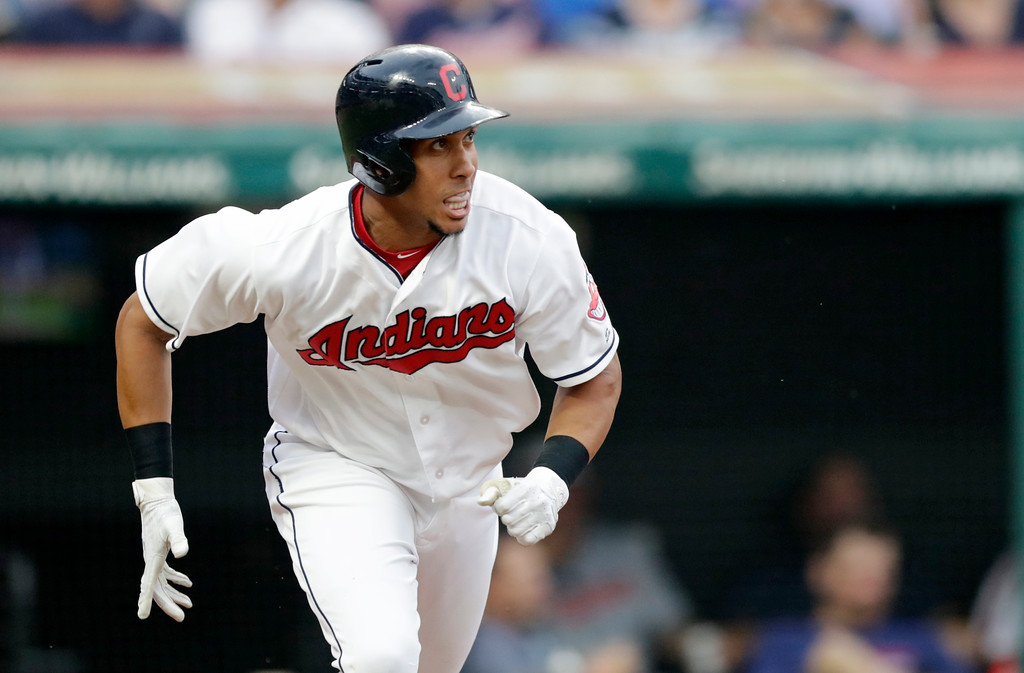 . Cleveland Indians\' Michael Brantley watches his ball after hitting a single off Minnesota Twins starting pitcher Kyle Gibson in the third inning of a baseball game, Monday, Aug. 6, 2018, in Cleveland. (AP Photo/Tony Dejak)