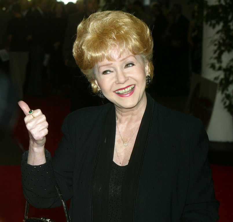 . Actress Debbie Reynolds arrives at Peterson\'s 10th Anniversary Gala at Peterson\'s Automotive Museum on June 24, 2004 in Los Angeles, California. (Photo by Kevin Winter/Getty Images)