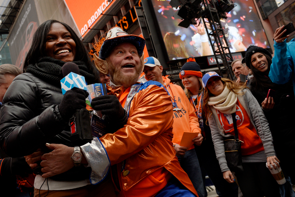 ". Rocky Brougham ""The Colorado Leprechaun\"" jokes with Enisha Vargas of the NYC Transit department while filming a promotion in Times Sqare in New York, NY January 31, 2014. The NFL has transformed 13 blocks of Broadway into a center for Super Bowl activity before Sundays Super Bowl between the Denver Broncos and Seattle Seahawks. (Photo By Craig F. Walker / The Denver Post)"