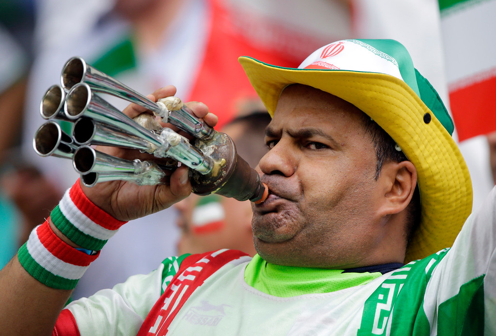 . An Iranian supporter blows a horn before  the group F World Cup soccer match between Bosnia and Iran at the Arena Fonte Nova in Salvador, Brazil, Wednesday, June 25, 2014. (AP Photo/Sergei Grits)