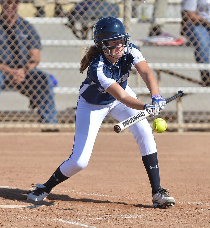 . 0314_SPT_TDB_L_CAR-NORTH--- Torrance, CALIFORNIA--3/13/13--- Staff Photo: Robert Casillas / LANG--- Carson at North Torrance softball. North\'s Rachael Sandoval lays down a bunt.