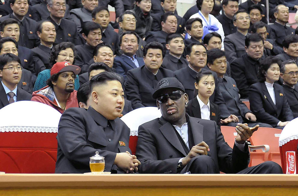 . North Korean leader Kim Jong-Un (front L) and former NBA star Dennis Rodman (front R) speak to each other during a basketball game in Pyongyang. Flamboyant former NBA star Dennis Rodman has become the most high-profile American to meet the new leader of North Korea, vowing eternal friendship with Kim Jong-Un. KCNA/AFP/Getty Images
