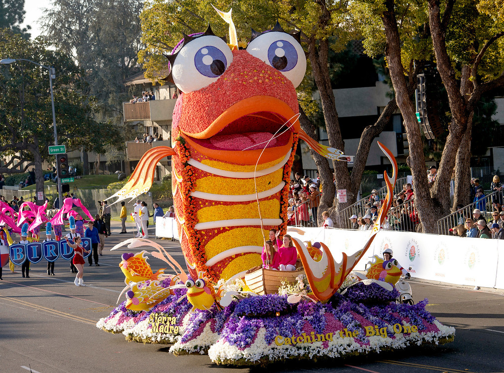 ". Sierra Madre rose Float Association ""Catching the Big One\"" float during 2014 Rose Parade in Pasadena, Calif. on January 1, 2014. This float won Mayor\'s Award for most outstanding City Entry. (Staff photo by Leo Jarzomb/ Pasadena Star-News)"