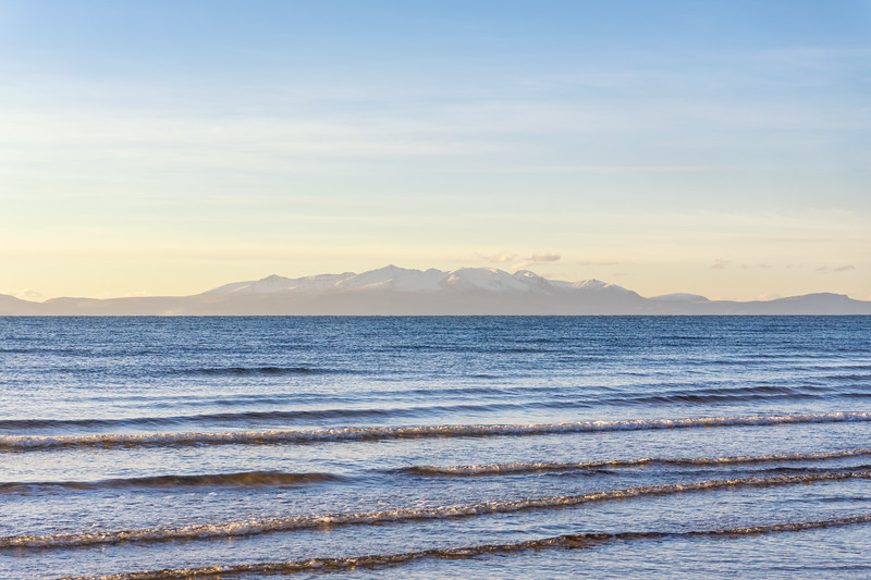 Looking across from Irvine foreshore to the Isle of Arran on a cold freezing day in January.