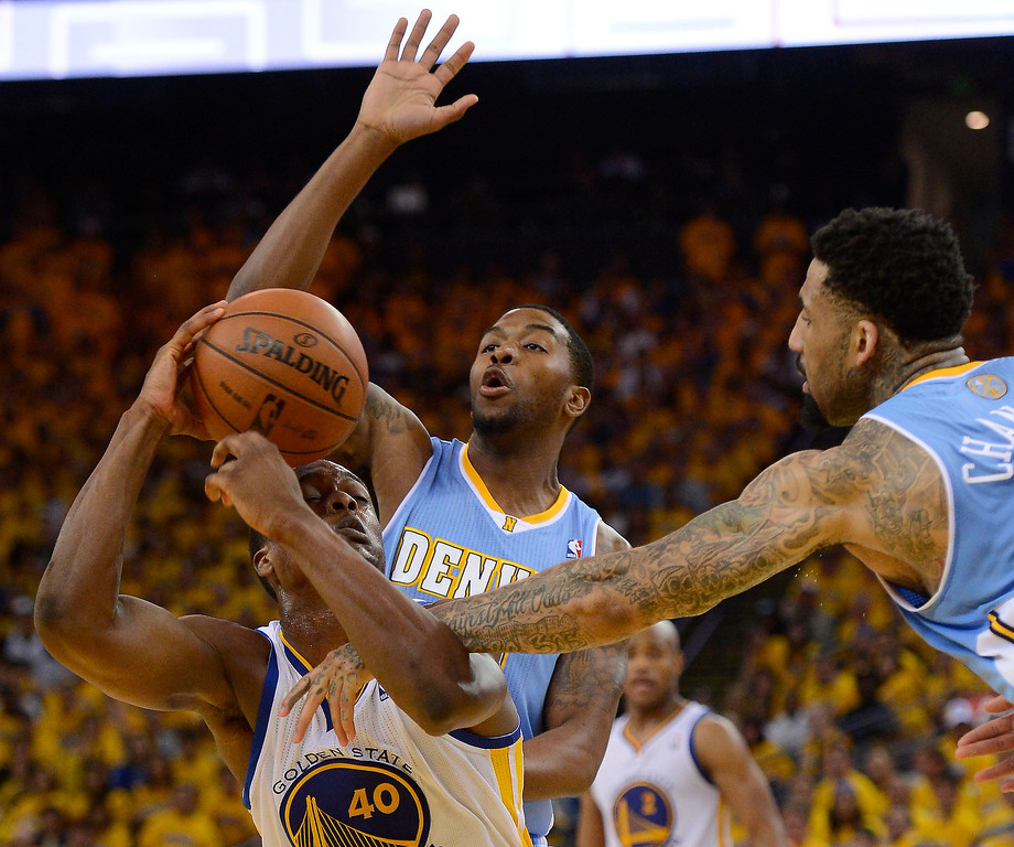 . Wilson Chandler (21) of the Denver Nuggets fouls Harrison Barnes (40) of the Golden State Warriors on the arm during the fourth quarter in Game 4 of the first round NBA Playoffs April 28, 2013 at Oracle Arena. (Photo By John Leyba/The Denver Post)