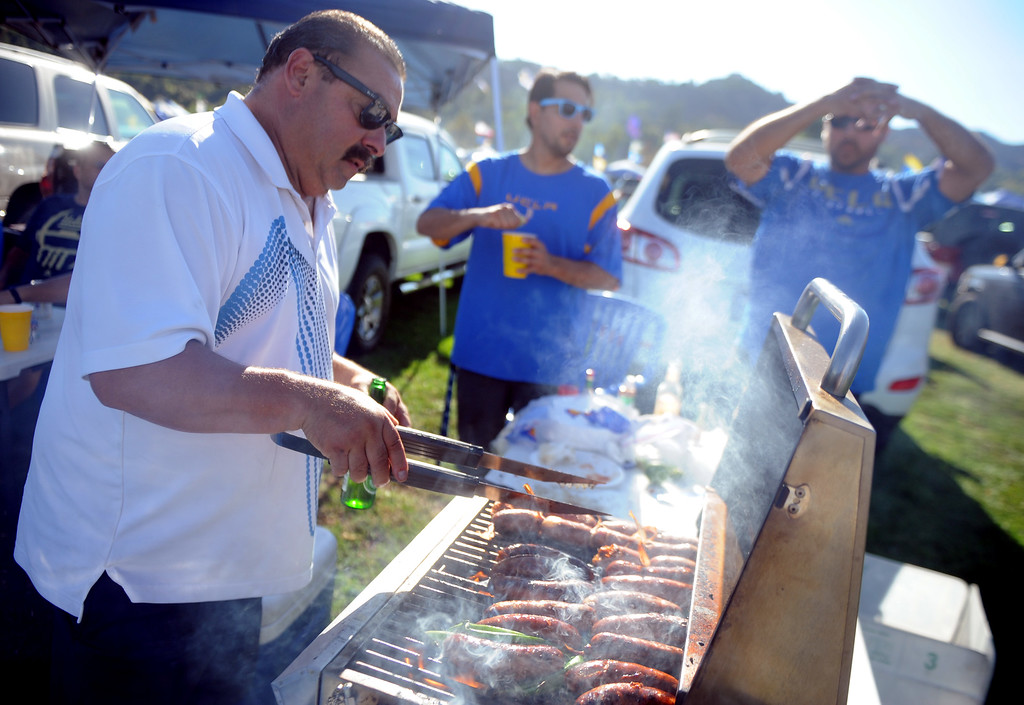 . J.R. Marquez of Los Angeles bbq\'s prior to a college football game between Nevada and UCLA in the Rose Bowl on Saturday, Aug. 31, 2013 in Pasadena, Calif.    (Keith Birmingham Pasadena Star-News)