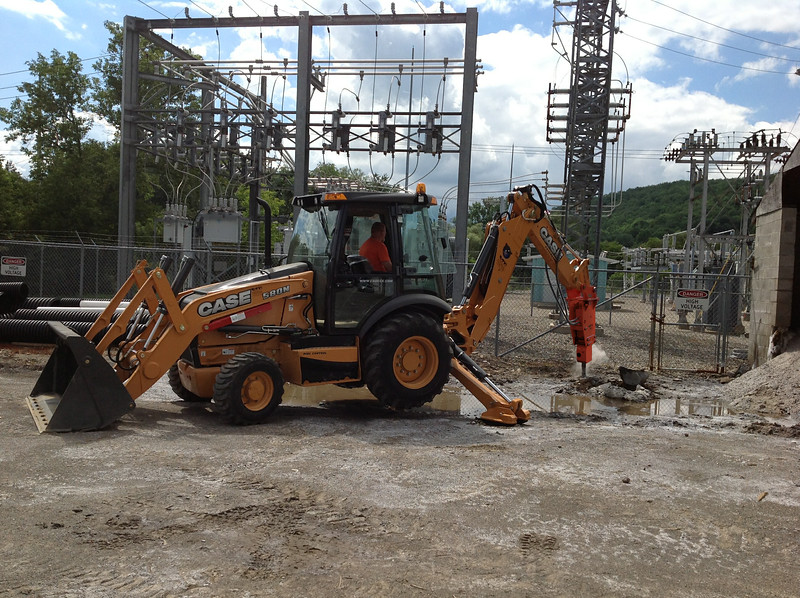 NPK PH4 hydraulic hammer on Case 580N backhoe excavating for site development.jpg