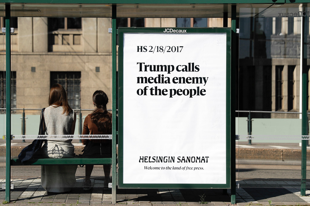 . A poster reading \'Trump calls media enemy of the people\' is displayed by Finnish newspaper Helsingin Sanomat at a stop for public transport in Helsinki, Sunday, July 15, 2018. U.S. President Donald Trump and Russian President Vladimir Putin will meet Monday at Finnish presidential palace in Helsinki that overlooks the Baltic Sea � the same venue where two of their predecessors met in 1990. (AP Photo/Markus Schreiber)