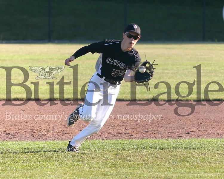 Cranberry's Nick Matthews fields a ball from shortstop against Butler Tuesday evening. Seb Foltz/Butler Eagle