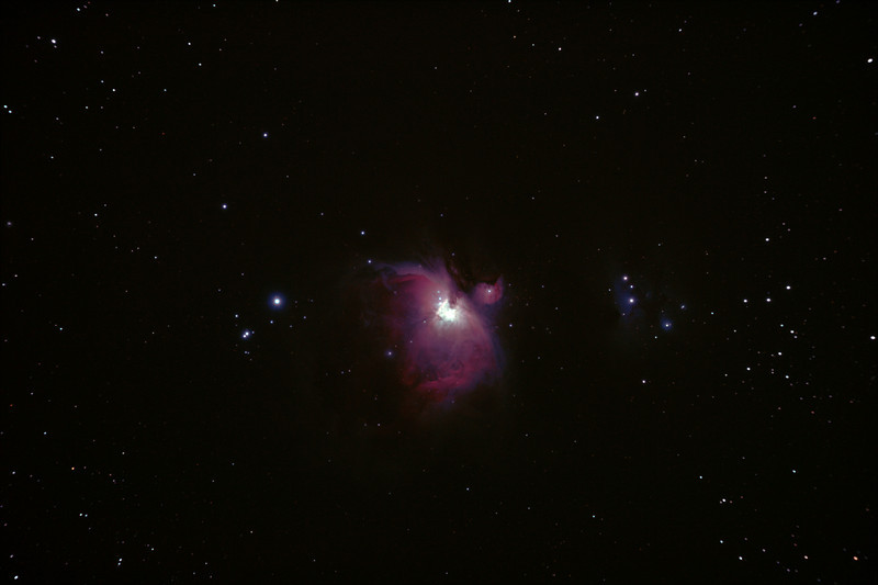 Messier M42 NGC1976 Orion Nebula - 3/1/2011 (Processed stack)   The 'Great Orion Nebula' is located in the sword of Orion and is one of the brightest nebula in the sky, and perhaps the best known. It is a young star formation region with very hot high-UV stars ionising and 'lighting' the nebula.The brightness of these young stars make this an astrophotography challenge as the central regions are very bright in comparison to the tenous outer nebula and over exposure becomes a problem. High Dynamic Range (HDR) techniques must be used to produce an image with a 'flattened' brightness range, more akin to the way the human eye perceives a wide range of brightness.   DeepSkyStacker 3.3.2 Stacked 80% of 20 Images ISO 800, 120 Sec, 11 DARK, 0 BIAS, 0 FLATS, post processed with Adobe Photoshop CS5. Intended for use as part of an HDR stack... see 2 other image stacks this date as well as an HDR combination of them.  Telescope - Apogee OrthoStar LOMO 80/480 with Hotech SCA T-Adapter, Hutech IDAS LPS-P2 filter, Canon 400D DSLR, Ambient xxC (not recorded). Mount - Skywatcher NEQ6 Pro. Guidescope - Orion ShortTube 80 with Star Shoot Auto Guider.