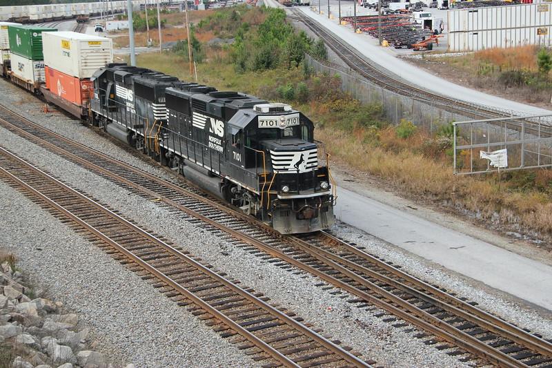 G90-06 [Whitaker Intermodal Local; Austell, GA]  NS 7101 (GP60) NS 7106 (GP60)  Switching domestic doublestacks at Whitaker Yard to Runaround at NS England, Whitaker Yard, Austell, GA.